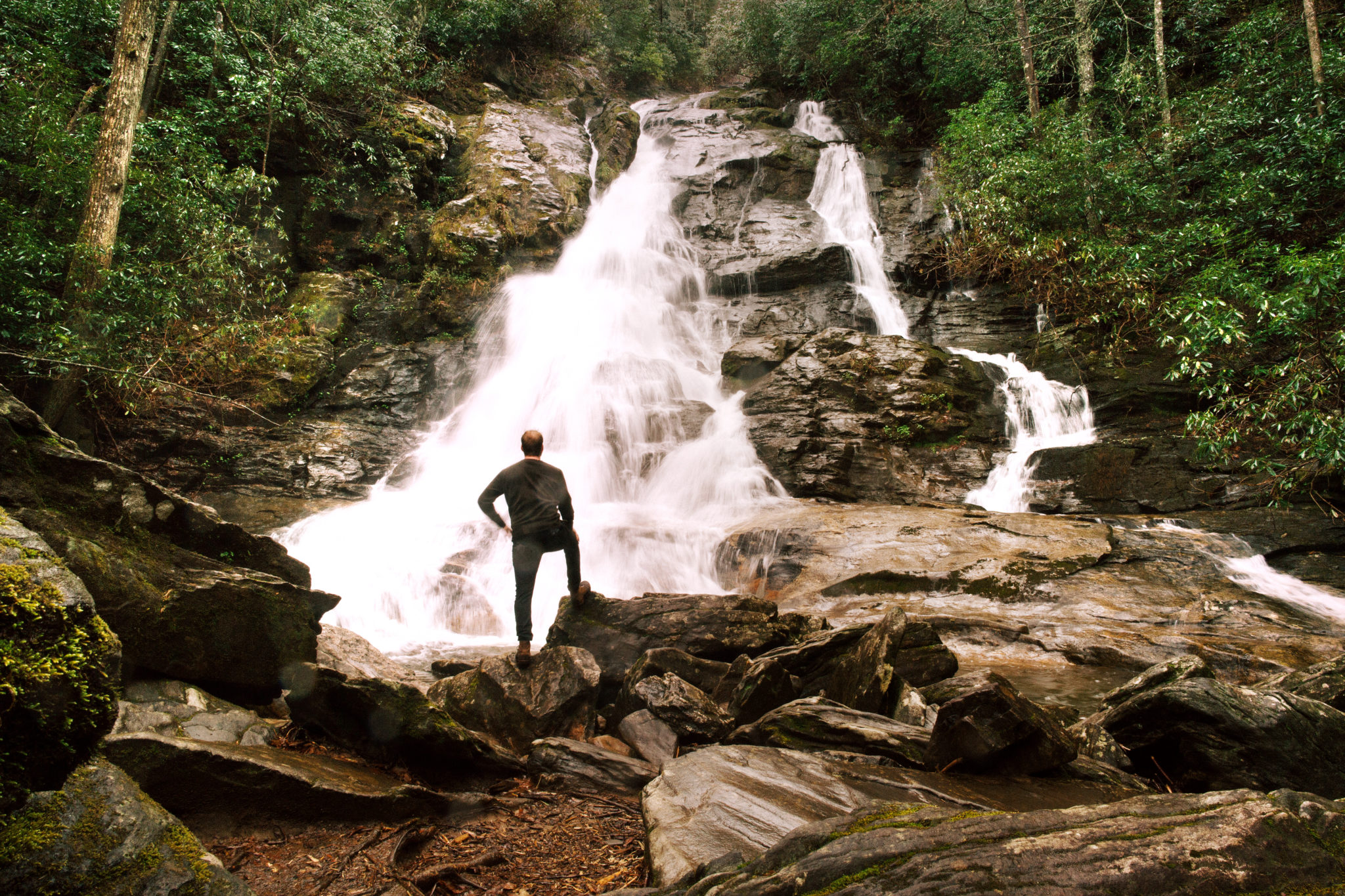 a man standing in front of High Shoals Falls near Young Harris, GA
